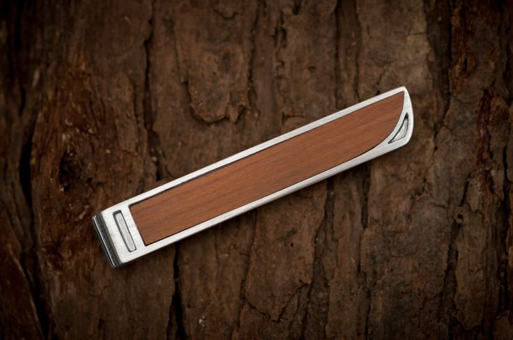 New Zealand native Rimu timber and silver tie slides are in stock! A perfect match with our Rimu cufflinks. By The Rolling Mill, Wellington, New Zealand.