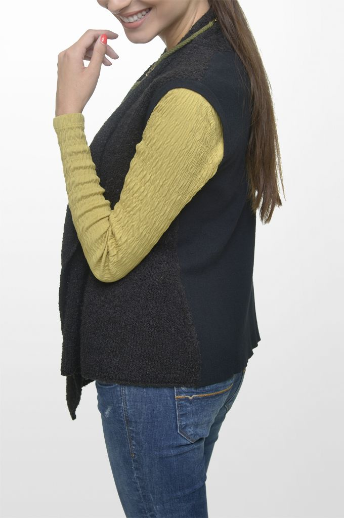 Sarah Lawrence - asymmetrical knitted vest, jersey blouse with combination of two fabrics, skinny denim pant, necklace.
