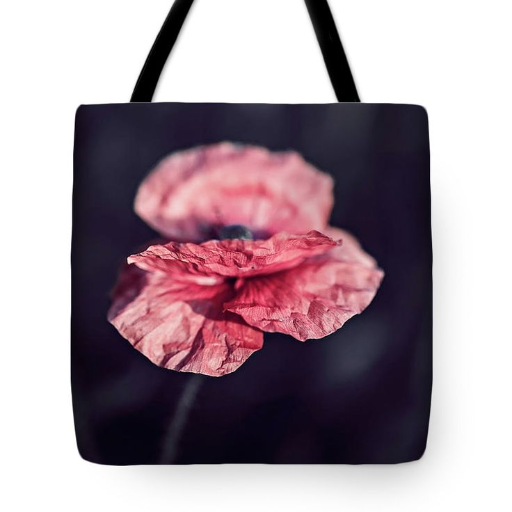 Tote Bag featuring the photograph Poppy Flower At Midnight by Oksana Ariskina Pink poppy flower blooming, floral dark gloomy natural spring vintage hipster black background.  Available as mugs, posters, greeting cards, phone cases, throw pillows, framed fine art prints, metal, acrylic or canvas prints, shower curtains, duvet covers with my fine art photography online: www.oksana-ariskina.pixels.com #OksanaAriskina