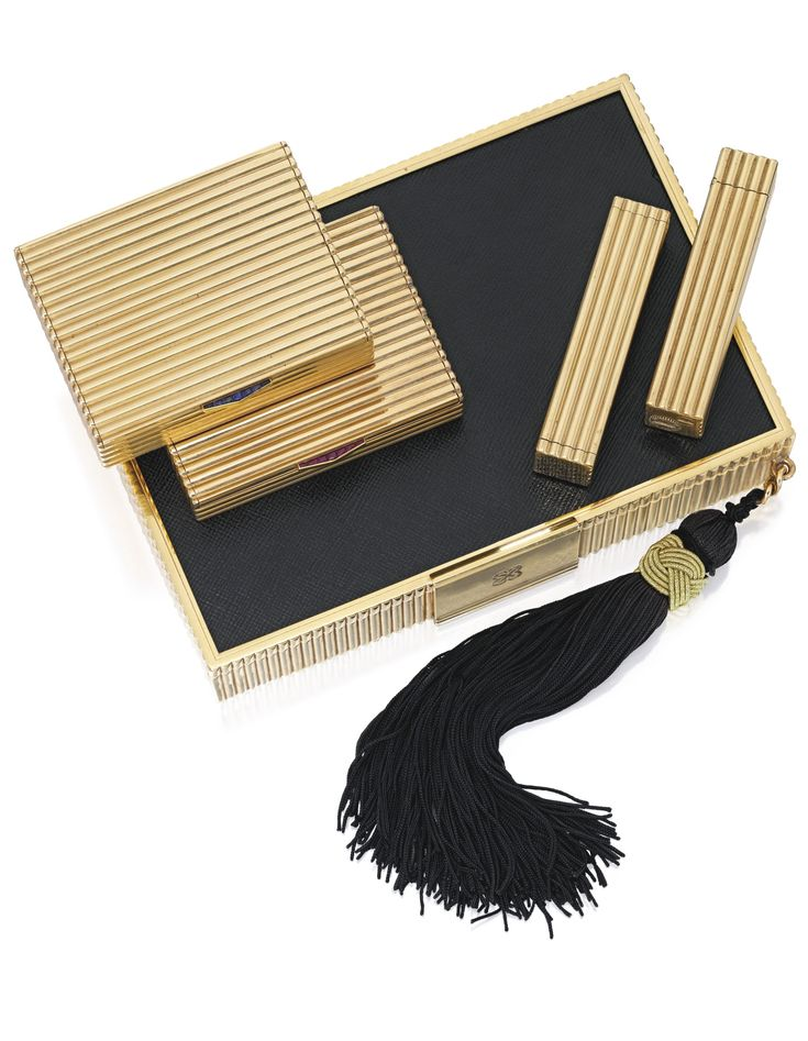 Sotheby's Auction estimate $20,000 to $30,000:  14 Karat Gold and Leather Vanity Case by Cartier (circa 1945)