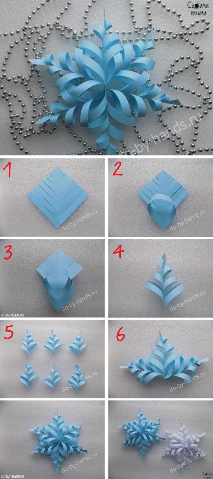 Schneeflocke von sechs Quadraten Papier, jedes