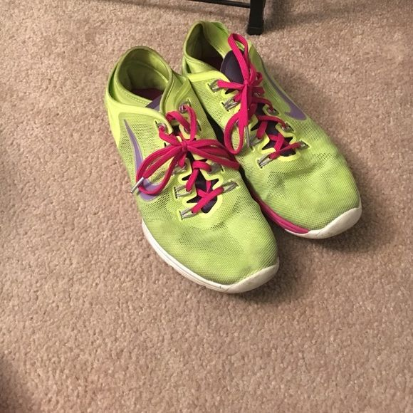 Nike training shoes Nike training shoes. Size9. Worn. Good condition. Neon yellow with hot pink accents Nike Shoes Athletic Shoes