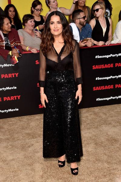 Salma Hayek Sheer Top - Salma Hayek's famous assets were on display in a sheer black Saint Laurent blouse at the premiere of 'Sausage Party.'