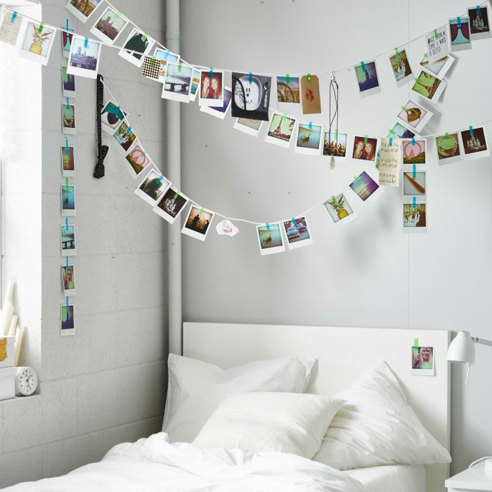 Picture perfect A photo garland feels festive and personal at the same time. Make it totally you by adding notes, tickets stubs and other mementos.