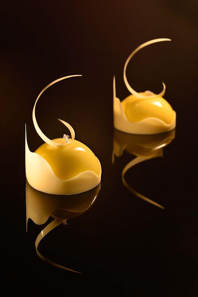 Ivory Lemon: Lemon shortcrust layered with lemon curd, lemon mousse & raspberry foamy.
