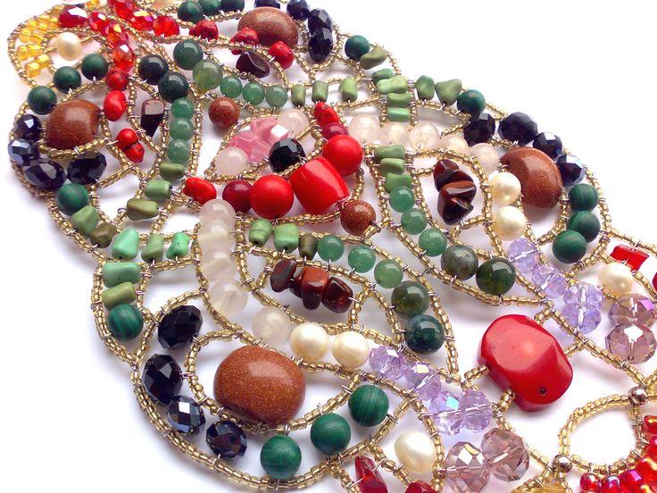 """Odyssey"" Statement bracelet.  Red Coral, Goldstone, Green Turquoise, Green Aventurine, Green Agate, Rose Quartz, Malachite, Freshwater Pearl, Cat's Eye, Tiger's Eye, Swarovski Crystals. www.musesa.com"