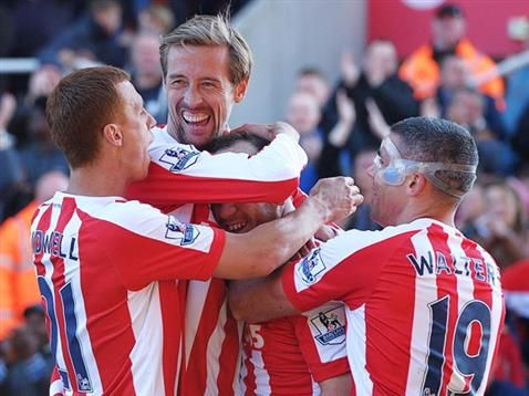 Charlie Adam is mobbed by Steve Sidwell, Peter Crouch and Jonathan Walters following his goal against Southampton