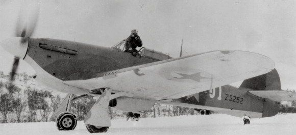 Soviet general A. A. Kuznetsov climbs from a British Hurricane cloaked in Soviet colors. (National Archives)