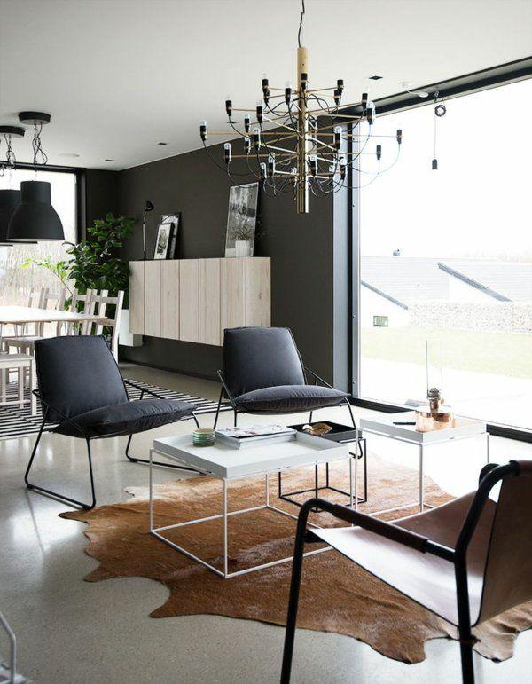 designer möbel im wohnzimmer kuhfell teppich verlegen