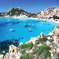 Sardinia, Italy, where Sophie and Rico cruise on a private yacht, gazing at the Milky Way...