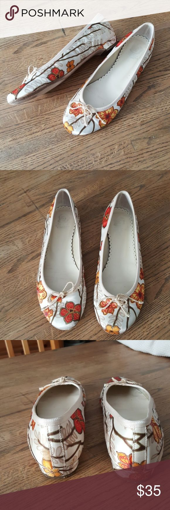 Ursula Mascaro silky floral ballet flats These shoes are adorable and in very good used condition. These add a little pop of color when worn with a solid color bottom. Exterior is a satiny silky cream color floral printed fabric with red, tan, brown, orange and yellow. Interior and sole are leather.  1/2 inch heel and corded tie at the front. Quality designer construction and comfortable to wear. Ursula Mascaro Shoes Flats & Loafers