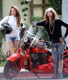 Rock 'n' roll: Steven Tyler and his rumoured fiancée Aimee Ann Preston rode motorbikes during their romantic Hawaiian holiday on Monday
