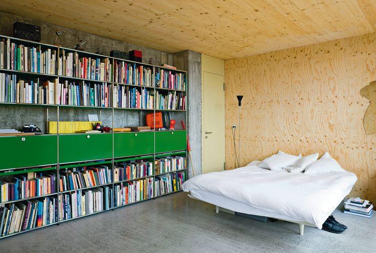 Modular home library - USM Haller shelving in USM green. www.usm.com