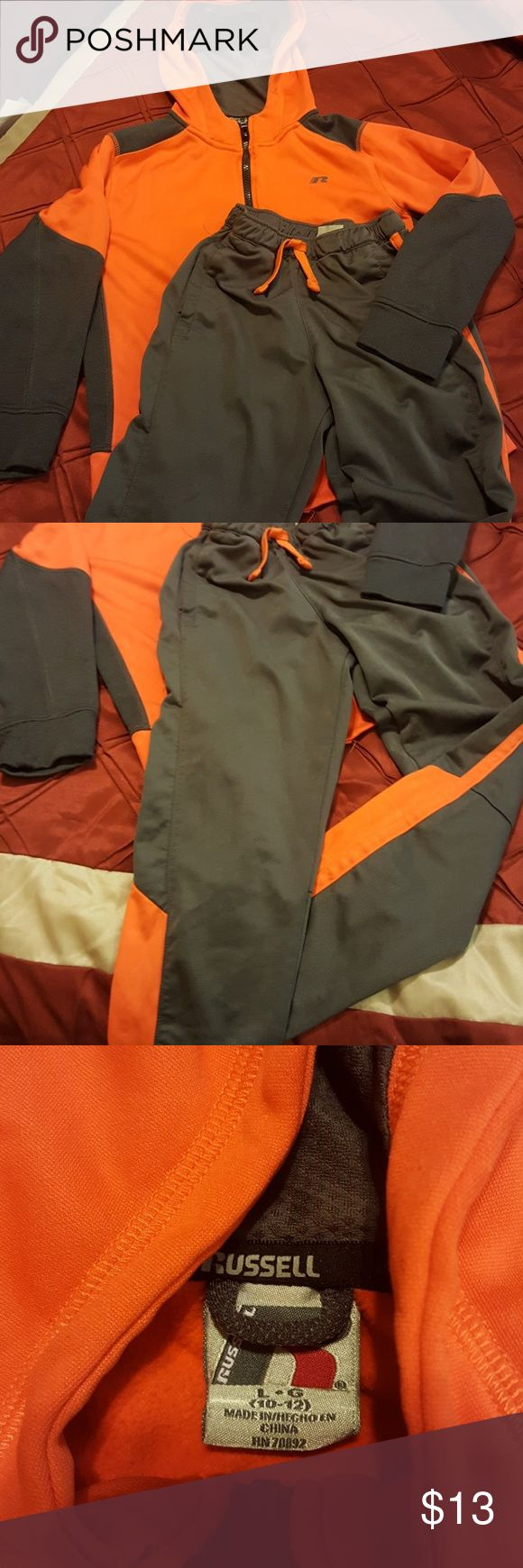 Boys jogging suit This is a boys jogging suit by Russell Athletics in charcoal gray and orange.  The hoodie is a 10/12 and the pants are an 8.  This is in excellent used condition.  Very vibrant! Pants have elastic waist and a drawstring. Russell Matching Sets
