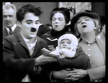 Erich von Stroheim's son, Erich Jr. appears as a baby (with beautiful eyes!) in Easy Street with Charlie Chaplin. (1917)