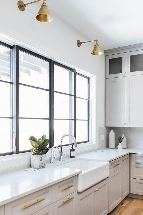 wonderfully designed kitchen features light gray shaker cabinets adorned with brass pulls and a on kitchen decor grey cabinets id=70571