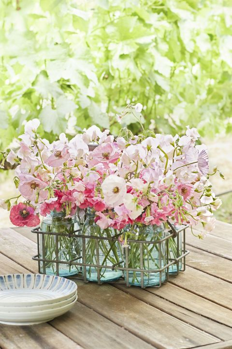 Mason Jars Feature colorful mason jars in a metal milk carrier for an easy, beautiful centerpiece.
