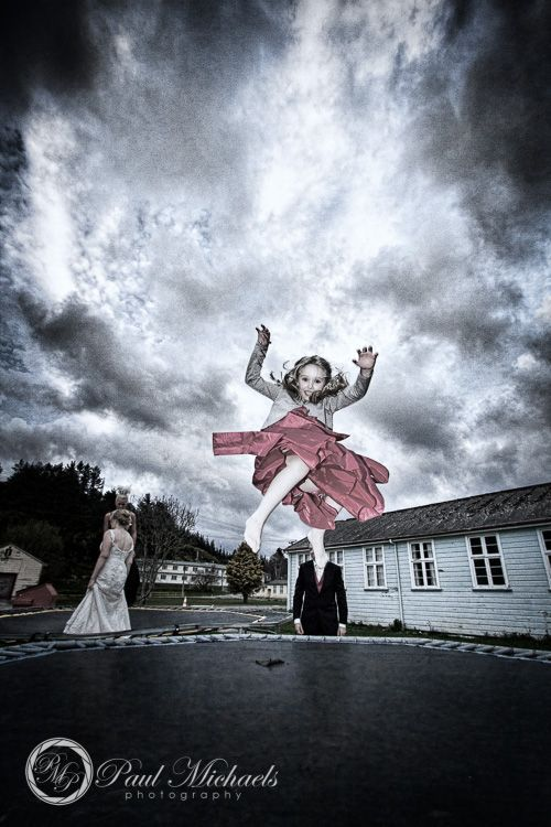 flowergirl on the trampoline. Wedding photography Wellington http://www.paulmichaels.co.nz/