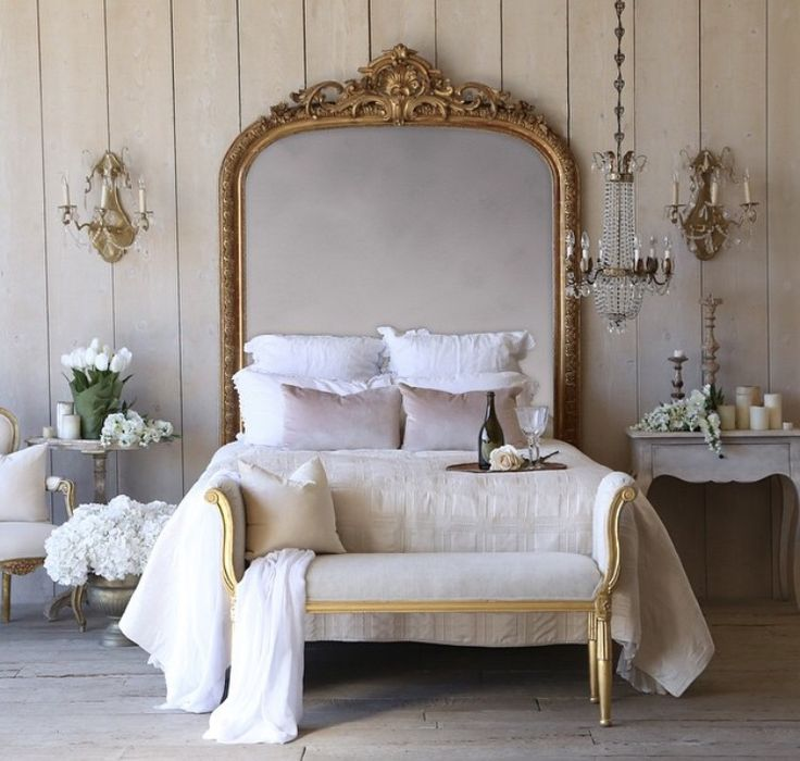Large gold mirror as a headboard , stunning . Love the grey bedside and chandelier , for similar try  Www.melodymaison.co.uk