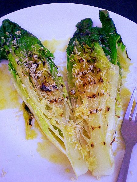 grilled romaine ........ Always one of my favorite side dishes. Simply wash, cut in half, season with olive oil, salt, pepper and garlic.  Grill quickly.  Love it!