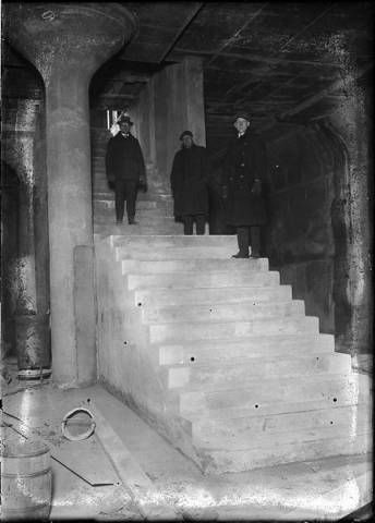 Oak Street subway entrance,1923 :: Rochester NY. Three unidentified men stand on the steps that lead down to the loading platform for the Oak Street subway stop. This photograph clearly shows the walls of the subway embankment and the flared concrete pillars that hold up the roof of the subway tunnel .