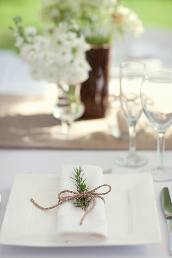 Napkin wrapped with string and a bit of rosemary. A nice touch.