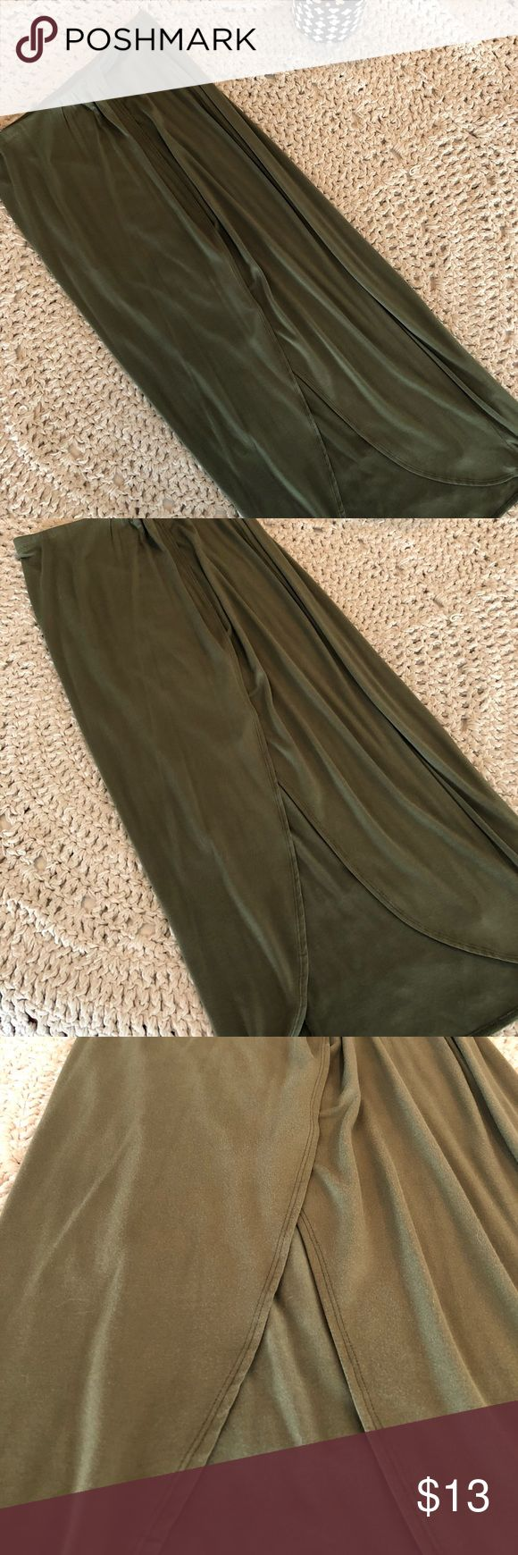 Charlotte Russe Olive Maxi Skirt This skirt has never been worn and I'm too embarrassed to say I can't pull it off! Seems to show almost every bump and curve but is so stylish. I love it! So cute and perfect for summer concerts or fall outfits. I like to say the opening and slit remind me of a tulip on the bottom. Great color and quality for the brand. Charlotte Russe Skirts Maxi