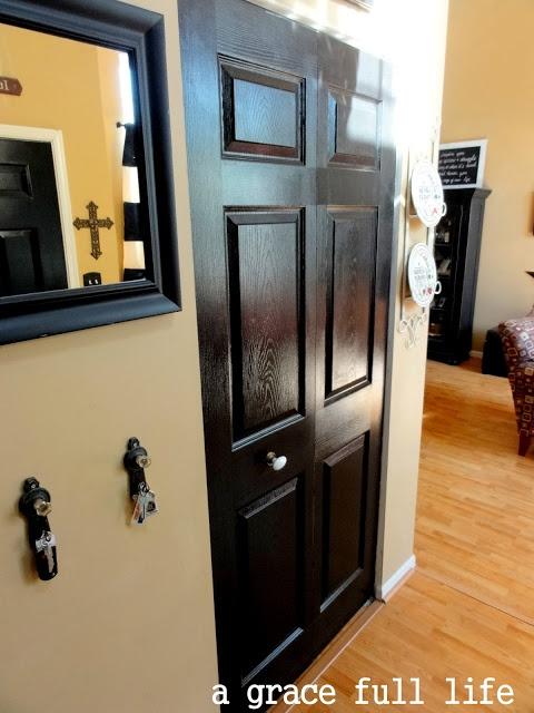 Black closet door white baseboard