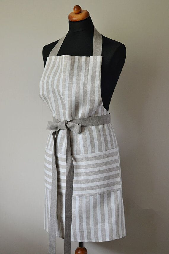 Linen Apron - striped full apron natural linen gray with white stripes and with one big pocket is stylish and elegant unisex cafe apron. Use it and feel like a best chef in the your kitchen.  • Apron size – 30.7 (high)x 27.5 (width) / 78cm (high) x70cm (width) • 100% pure Linen • color – natural linen • price for 1 apron  Apron is made from undyed linen and have one big pocket. The apron has one long belt, so you can easily to adjust to your figure. The belt goes from one side from the apron…
