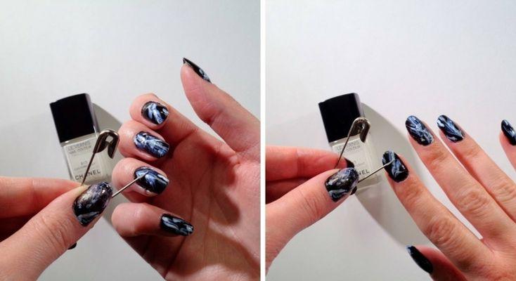 Nail art unghie a mandorla, base con smalto nero e decorazione effetto marmo da fare a mano