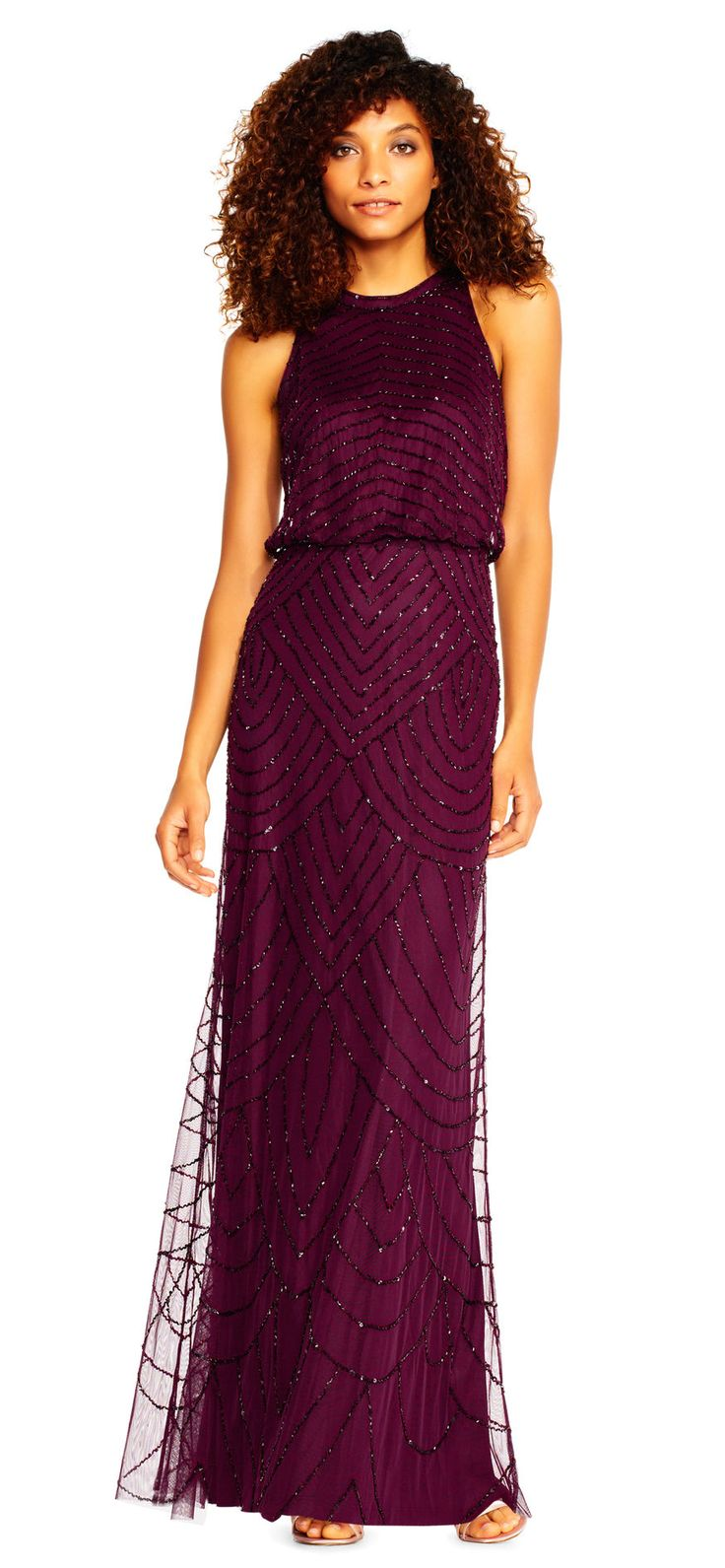 Art deco beading adorns this beloved halter dress from neck to hem. This beaded dress features a blouson bodice with a keyhole back, a flowing straight skirt, and a single button closure at the neckline. Sleek and sleeveless, this halter gown plays well with your favorite sparkling accessories from galas to bridesmaid duty.