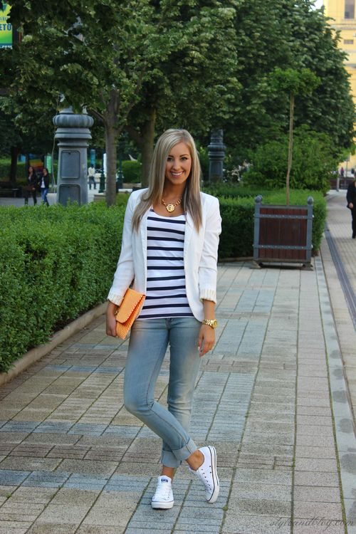 White blazer, striped blouse, jeans, and white  shoes