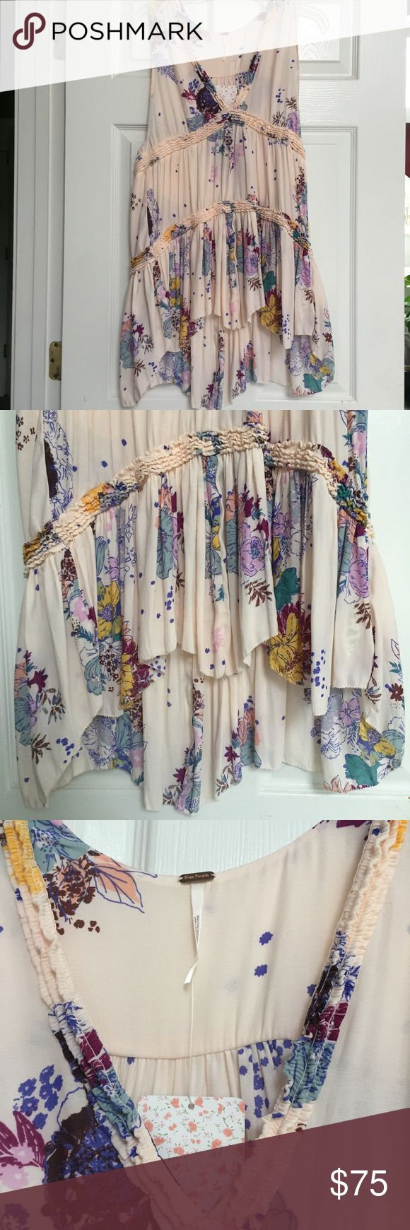 Free People Cream Combo Trapeze Dress Size S Free People trapeze dress. Cream Combo with hues of pink, purple, blue, yellow, burgundy.  Size S  100% polyester   NWT new with tags Beautiful and flowing Free People Dresses
