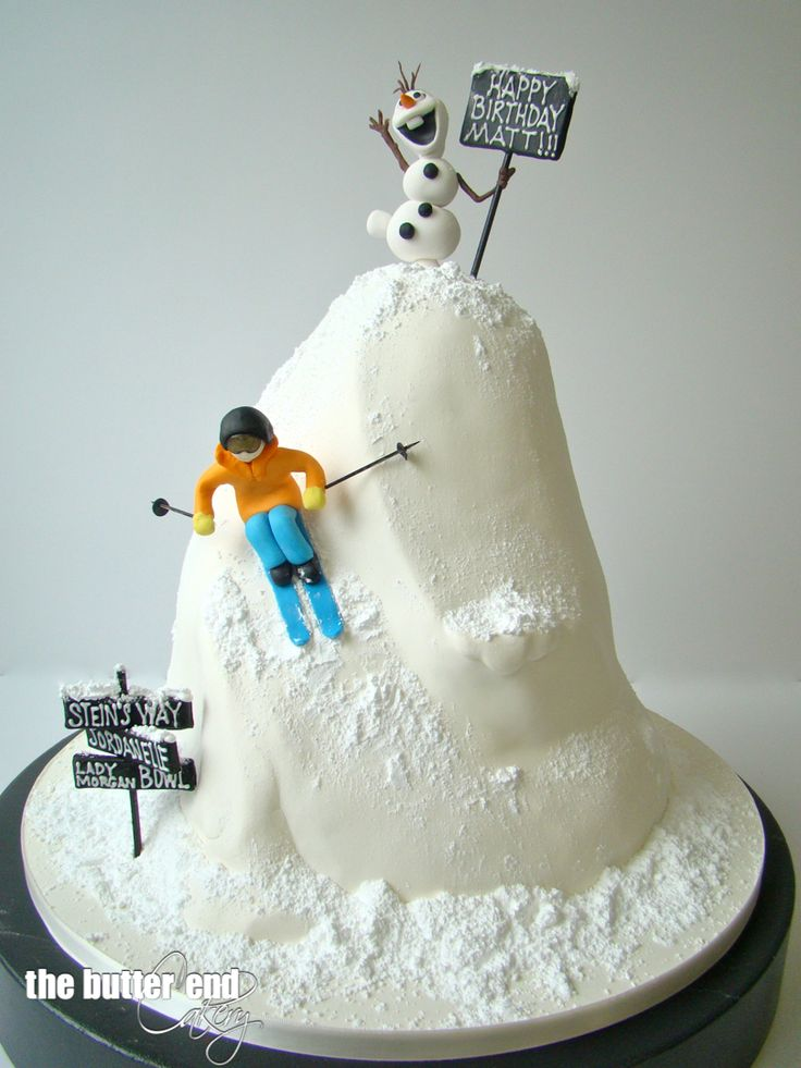 3-D sculpted skier cake with Disney's Olaf on top by The Butter End Cakery