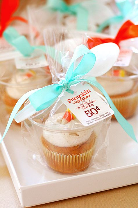 wanted to pass along an awesome idea I found here when searching for bake sale ideas for our school's Harvest Fest.  She came up with the genius idea of using 9 oz. plastic cups wrapped in treat bags to individually package cupcakes. Add a little spoon tied on to it.