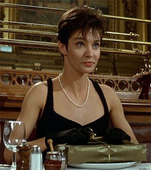 Nikita (Anne Parillaud) in a little black dress