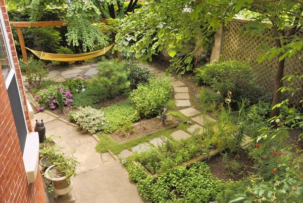 A view from the fire escape shows the varied textures in Barry Glassman's serene garden oasis at his Butcher's Hill rowhouse. (Amy Davis, Baltimore Sun)