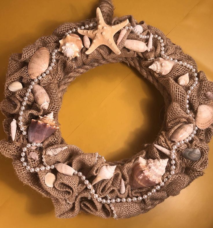 A personal favorite from my Etsy shop https://www.etsy.com/listing/507625524/burlap-and-shell-wreath