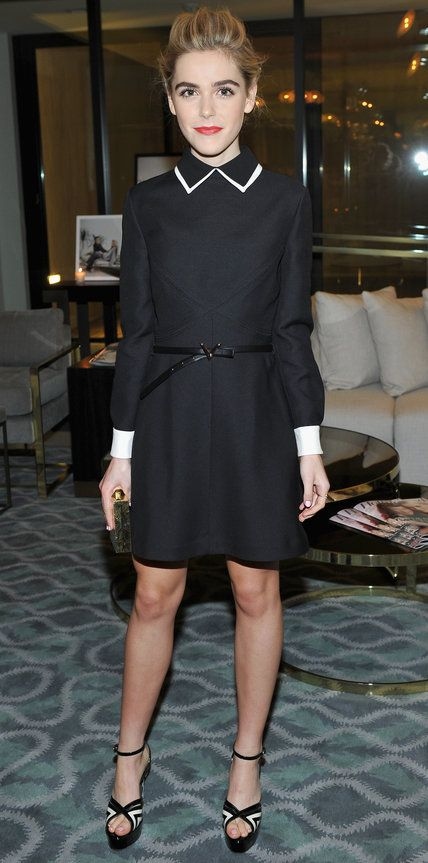 Kiernan Shipka in a collared long-sleeve LBD with white accents.