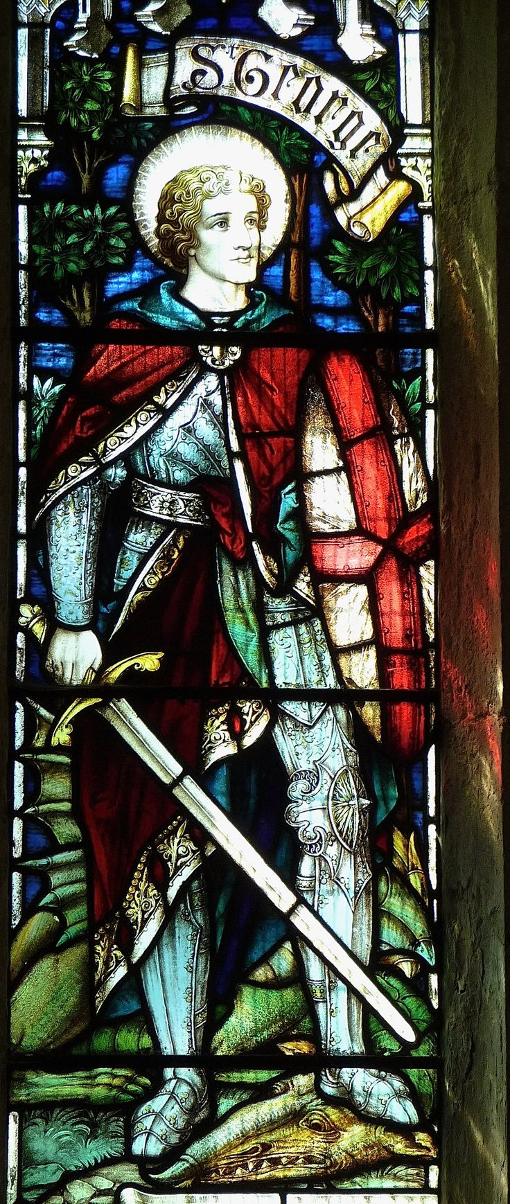 https://flic.kr/p/Jw7GCX | Tilney, All Saints - Stained Glass |  In the south aisle is found a window in memory of Gerald Watson Failes, Captain in the Norfolk Regiment, who was killed in 1918 aged 24.  An angel is flanked on the left by St George, patron Saint of England, and on the right by St Martin, Patron of English armourists.  Detail: St George and the dragon.