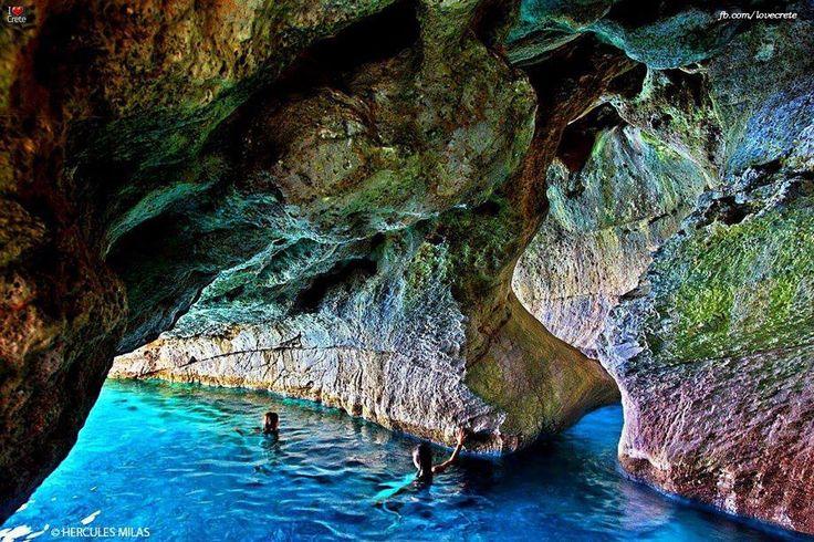 "Swimming in the sea caves next to Marmara (or ""Dialeskari"") beach, close to Loutro village, Sfakia, Chania, Crete, Greece."