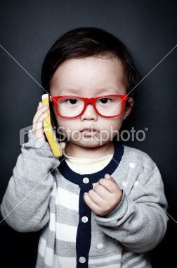 Cute Asian baby Mobile phone Royalty Free Stock Photo