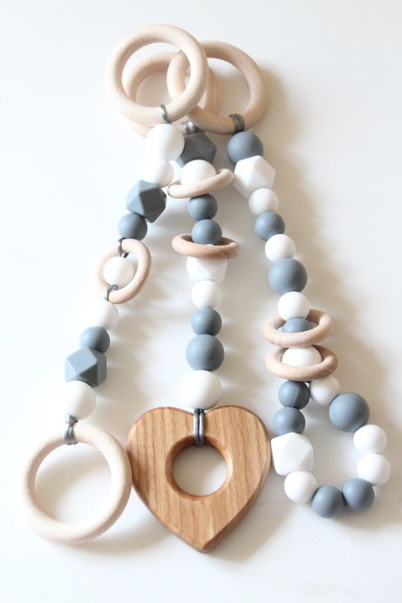 Baby gym toy set of 3 / Teething toy for newborn / Stylish and natural / Hanging toy set Natural and stylish baby gym toys. Made from natural materials. Baby will love different types of materials. Easy to grab and play with. Your baby will surely like this TOY. Her/his little arms will be occupied and her/his motor skills developed. Crocheted surfaces are pleasant to touch, wooden rings and food grade silicone beads are durable enough for teething. Beads are made from 100% food grade…