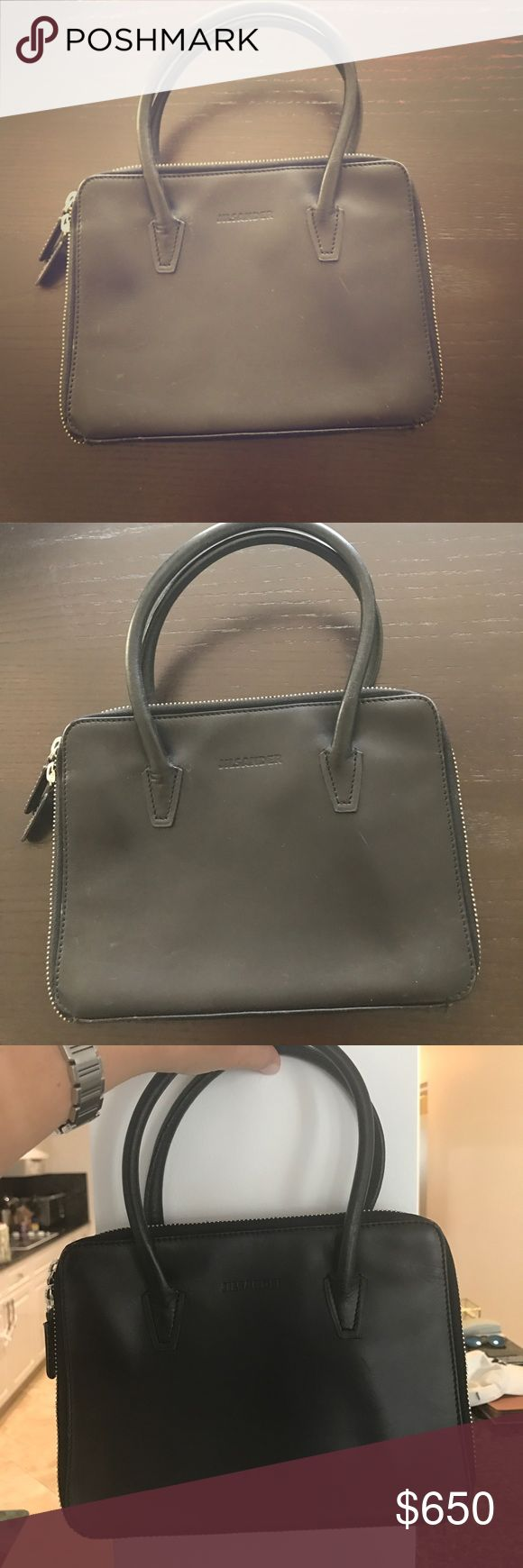 Jill sander leather evening bag This super cool evening bag is one of a kind. It's ultra cool flat look dresses up any outfit for a night out. Great, durable leather. Super cool handle that fits on wrist for a sophisticated look. Zip around closure. Jill Sander Bags Mini Bags