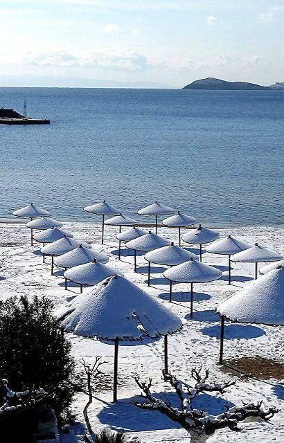 Beach covered with snow.. Karystos, Euboea, Greece | by © Menelaos Goros