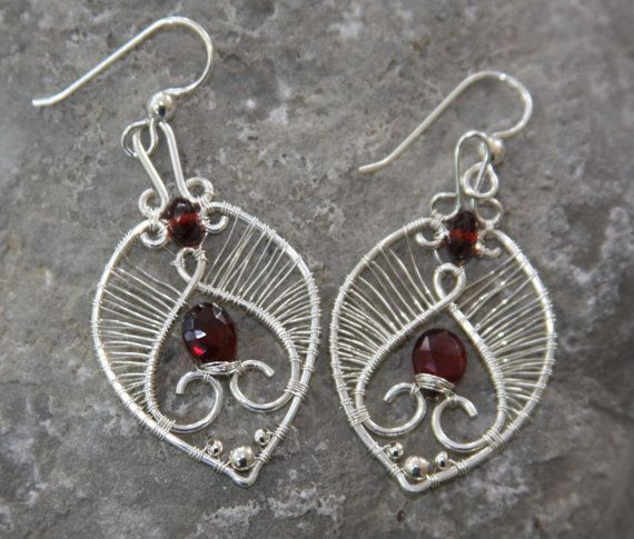 $135 Etsy listing at http://www.etsy.com/listing/97772934/pyrope-garnet-wire-weave-earrings