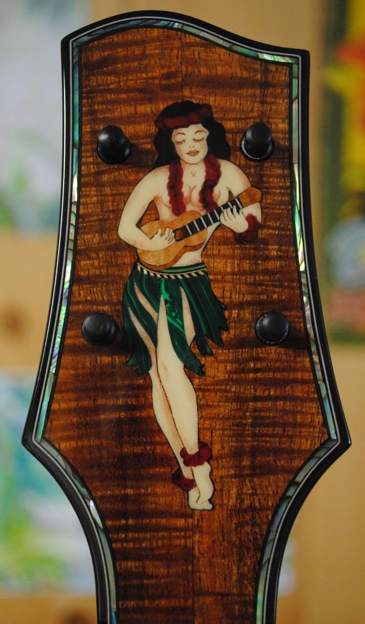 Sailor Jerry hula girl inlay on a Moore Bettah ukulele. Chuck makes really pretty ukes!