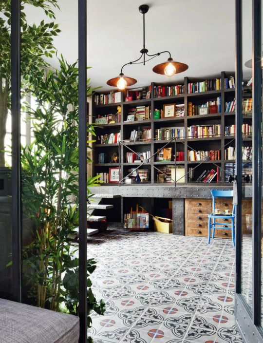 DAILYAROS...WOW....from the lighting, the lifted bookcase with walkway, all the way down to that beautiful flooring......