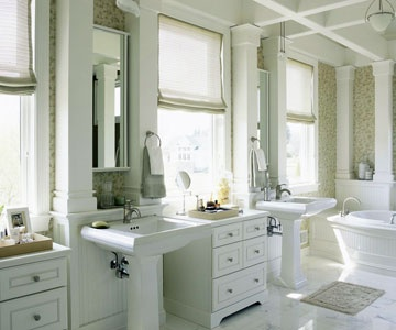 Bathroom With Pedestal Sinks And Functional Cabinet Between