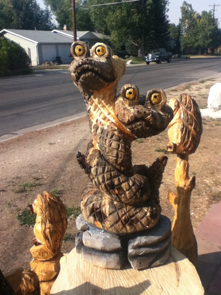 Love snakes incredible chainsaw carving by the bear guy